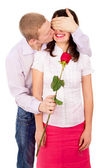 The guy gives a girl a rose, kisses — Stock Photo