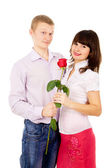 The guy makes a proposal to the girl with the rose — Stock Photo