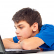 Boy tired for laptop play — Stock Photo #17377725