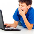 Boy with laptop isolated — Stock Photo