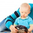 Dad plays with the baby on the joystick — ストック写真