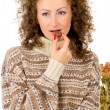 Stock Photo: Comfort, the girl in a sweater eating chocolate candy