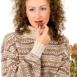 Comfort, the girl in a sweater eating chocolate candy — Stock Photo