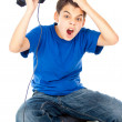 Frustrated boy with a joystick — Stock Photo #17379193