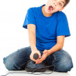 Funny guy with a joystick playing games — Stok fotoğraf