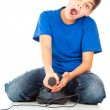 Funny guy with a joystick playing games — Stockfoto