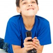 Funny guy plays with a joystick — Stockfoto