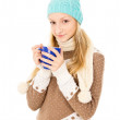 Stock Photo: Girl in cap with mug