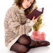 Girl in a sweater and a book — Stock Photo #17379757