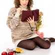 Girl in a sweater with a book — Stock Photo #17379845