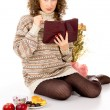 Girl in a sweater with a book — Stock Photo