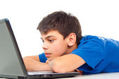 Boy tired for laptop play — Stock Photo