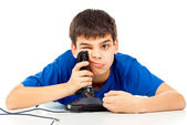 Boy tired of playing on the joystick — Stock Photo