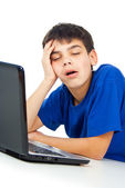 Boy tired of studying at a laptop — Stock Photo