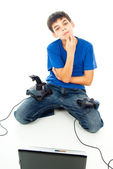 Boy with computer and with two joysticks — Stock Photo