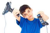 Boy with two joysticks plays — Stock Photo