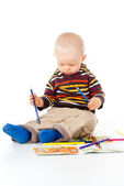 Child draws with pencils — Foto Stock