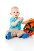 Child sitting with helmet — Stock Photo