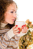 Close-up girl in a sweater with a mug — Stock Photo