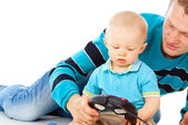 Dad plays with the baby on the joystick — Stock Photo