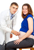Doctor examines a pregnant girl — Stock Photo