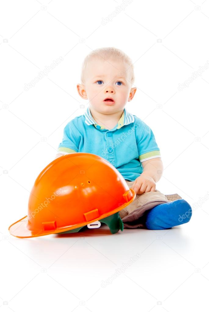Beautiful child with construction helmet  Stock Photo #17378263