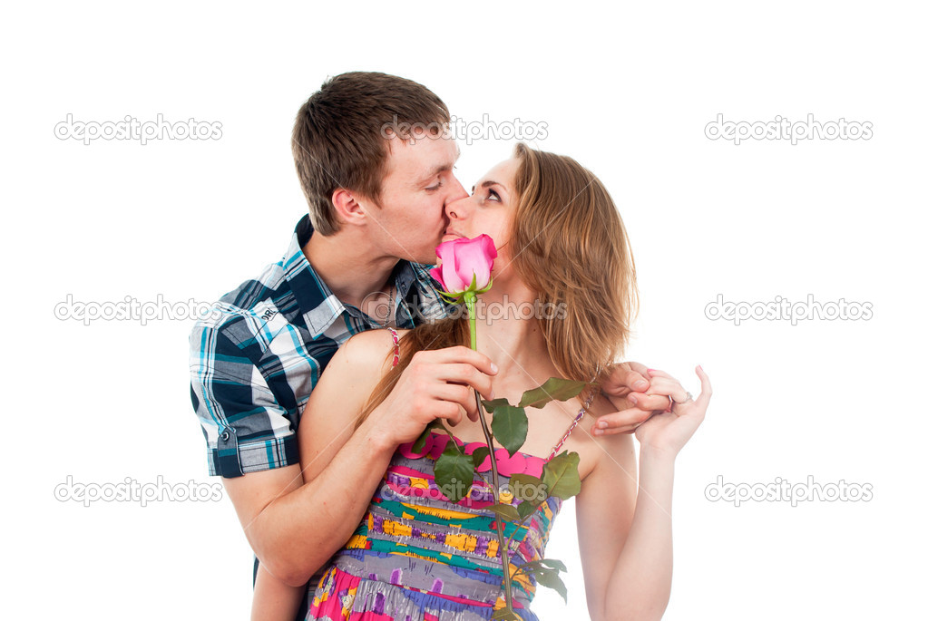 Kissing couple in love with a rose — Stock Photo #17378559