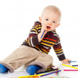 Stock Photo: Beautiful child draws with pencils
