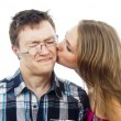 Beautiful girl kisses a guy on the cheek — Stock Photo #17381339