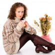 Beautiful girl sitting in a sweater with a mug — Stock Photo #17381895