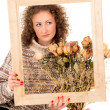 Stock Photo: Beautiful girl with a frame and still life
