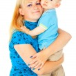 Beautiful mother holding a baby in her arms — Stock Photo