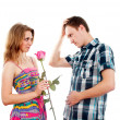 Boy and girl with a rose on a white background — Stock Photo