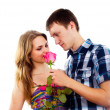 Boy gives a girl a rose — Stock Photo