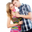 Boy gives a rose beautiful girl - Stock Photo