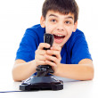 Boy plays games on the joystick — Stock Photo #17383497