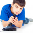 Boy plays on the joystick — Stock Photo #17383509