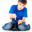 Boy plays on the joystick — Stock Photo