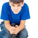 Boy plays with a joystick — Stock Photo #17383577