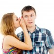 Girl says a guy in the ear — Stock Photo