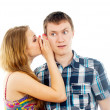 Girl says a guy in the ear — Stock Photo #17383937