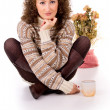 Stock Photo: Girl sits in a sweater and boots