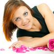 Girl with a rose and petals isolated — Stock Photo #17384403