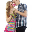Stock Photo: Happy boy and girl in love with rose