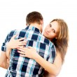 Stock Photo: Happy girl hugging loved one guy