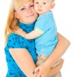 Stock Photo: Happy mother holding baby in her arms