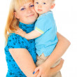 Happy mother holding a baby in her arms — Stock Photo