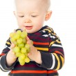 Little child holding grapes — Stock Photo #17386965