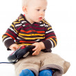 Little child plays with a joystick — Stock Photo #17386985