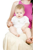 Babe sitting in the mother — Stock Photo